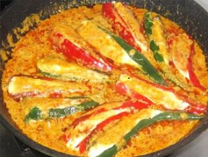 Cooking-stuffed-chilies-in-curry-sauce-for-Fragrant-Curry-Chilies-Stuffed-with-Fish-Paste-Recipe