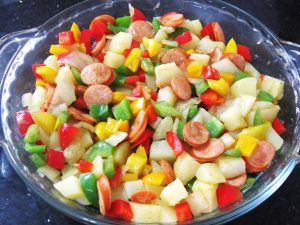 Add-fried-ingredients-to-the-potato-for-Baked-Potato-and-Sausages-with-Cheese-Recipe