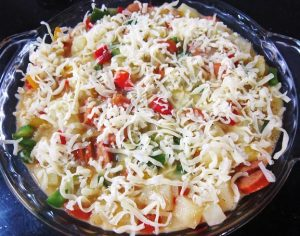 Sprinkle-Mozzarella-cheese-for-Baked-Potato-and-Sausages-with-Cheese-Recipe